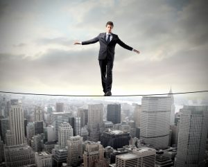 image showing a man on a tightrope